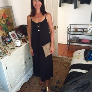 Casual black dress with simple gold necklace